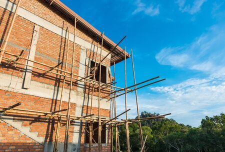 townhome: blue sky and townhome & Construction Site in progress to new house in Thailand