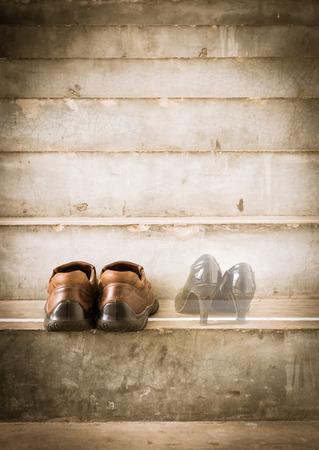 heartbroken: man and women shoes. heartbroken concept