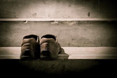 heartbroken: man and women shoes. heartbroken concept. Black and White photo