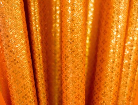 tissu or: agrandi fond tissu de texture d'or et soft focus