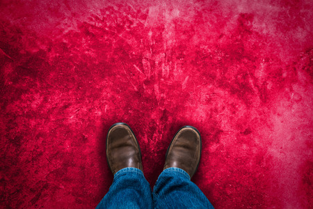 red pink: man leg with Brown leather shoes stand on red pink grunge cement background  space for your text  Stock Photo