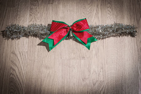 chrismas red bow  on wooden background Stock Photo