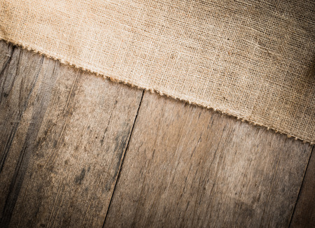 burlap: a Burlap and wooden  texture background