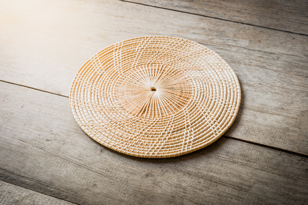 Wicker placemat on wooden table background