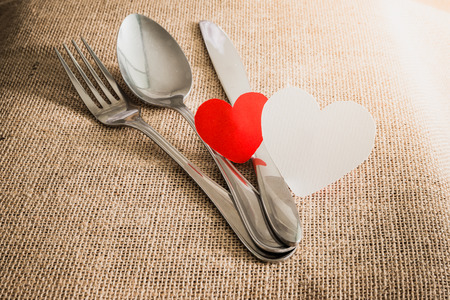 romantic places: Valentines Romantic Dinner concept with silverware on sackcloth textures Stock Photo