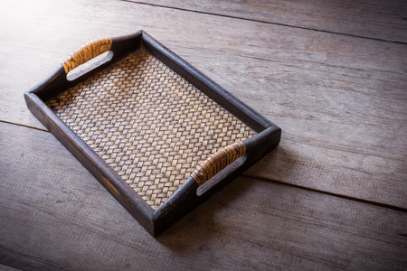 chinese bamboo: Chinese bamboo woven tray on wooden background