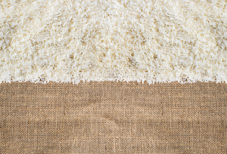 Rice on sackcloth can use for background. vertical view