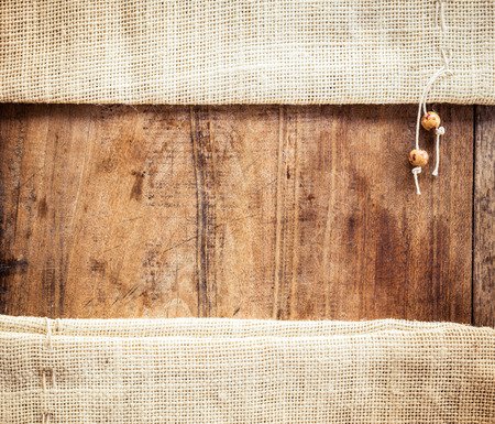 fabric cotton: Wood background with sackcloth bag. The view from the top Stock Photo