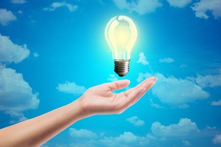 bluesky: Ideas bulb light on a hand. on bluesky background Stock Photo