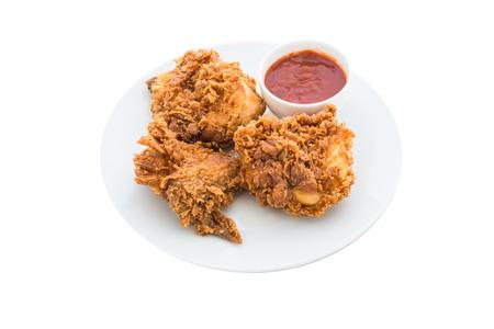 alimentos y bebidas: pollo frito est� aislado en el fondo blanco Foto de archivo