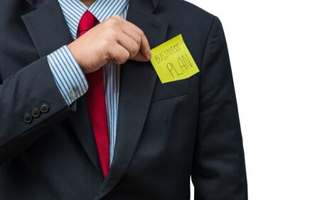 out of body: Part of body of business man who takes out Yellow notepad from the pocket of business suit,  isolated on white background. with clipping pat, business plan concept