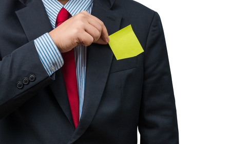 yellow notepad: Part of body of business man who takes out Yellow notepad from the pocket of business suit,  isolated on white background. with clipping pat, business plan concept
