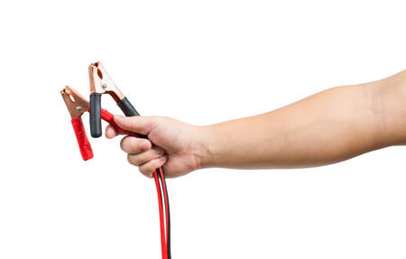 jumper: jumper cables in male hand isolated on white