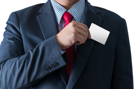 Part of body of business man who takes out business card from the pocket of business suit, copyspace, isolated with clipping path photo