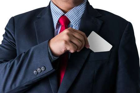 out of body: Part of body of business man who takes out business card from the pocket of business suit, copyspace
