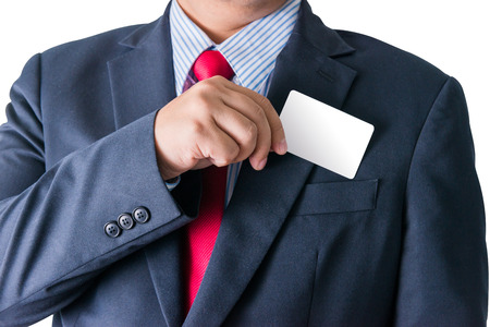 out of body: Part of body of business man who takes out business card from the pocket of business suit, copyspace. isolated on white background with clipping path Stock Photo