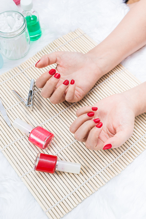 Manicure - Beautiful manicured woman's nails with red nail polish Standard-Bild