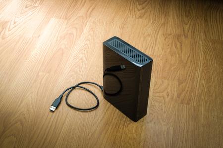 diskdrive: External hard drive on wooden background