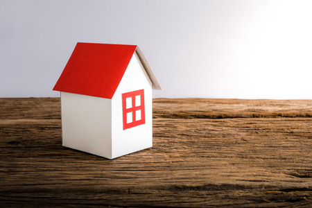 disorient: paper house symbolizing on wooden table. love family concept Stock Photo