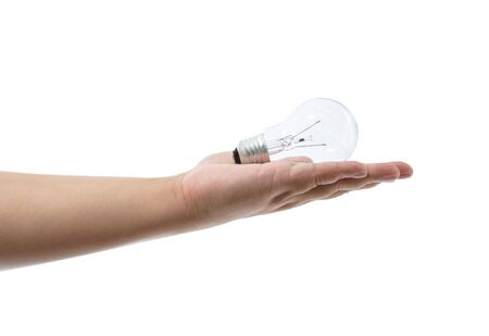 Hand holding an incandescent light bulb isolated on white background with clipping path