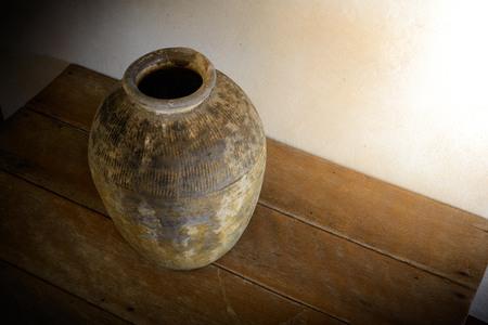 terracotta: antique terracotta jars  on wooden table Stock Photo