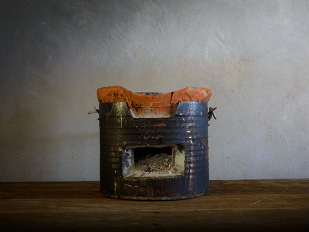 Antique charcoal stove on wooden floor