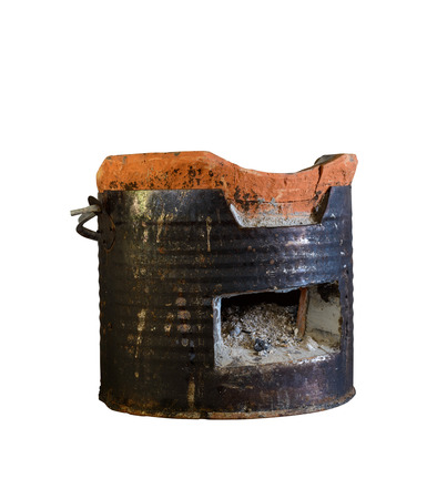 stoking: Antique charcoal stove  isolated on white with clipping path