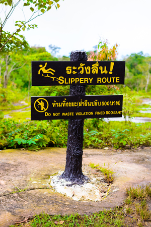 fined: warning sign SLIPPERY ROUTE,DO NOT WASTE VIOLATION FINED 500 BATH in Lan Hin Pum  (natural phenomenon) at Phu Hin Rong Kla national park, Phitsanulok Province, Thailand