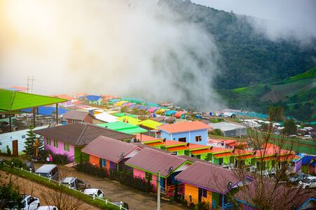 lodges: PHUTHAPBOEK PHETCHABUN THAILAND - OCTOBER 8 : Resorts and lodges on the mountain with sunset at morning from view point ,Phu Thap Boek,  OCTOBER 8, 2015 in PHETCHABUN THAILAND