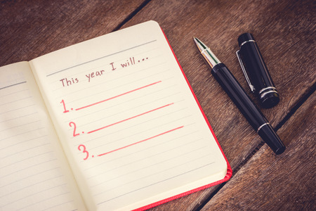 New Year Resolution, Empty list. on wooden table Archivio Fotografico