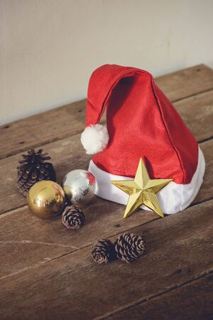 merry chrismas: christmas red hat and Decorated Christmas on a wooden background, Christmas background