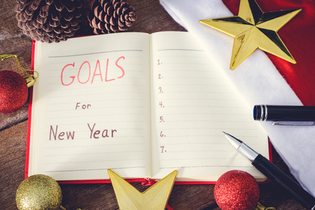 upcoming: New Years goals with colorful decorations. New Years goals are resolutions or promises that people make for the New Year to make their upcoming year better in some way Stock Photo