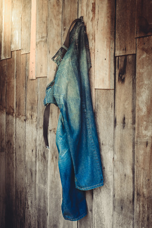 cotton  jeans: Vintage,Jeans hanging on the wooden wall background