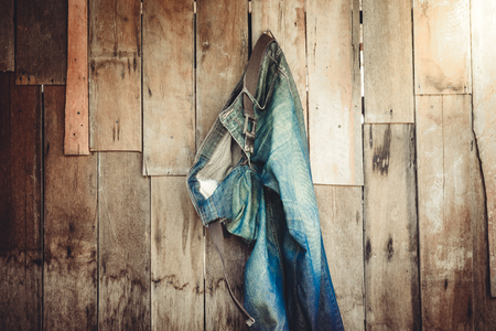jeans: Vintage,Jeans hanging on the wooden wall background