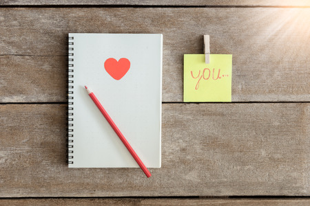love abstract: Notebooks, clip boards, Notepad, pencil Arranged in is the meaning I Love You. Valentine Concepts