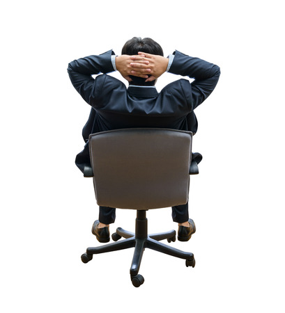 sits on a chair: backside, relaxed and dreaming business man sits on office chair isolated on white background Stock Photo