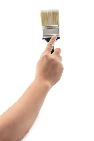 caulk: back view of hand holding paint brush with plastic black handle isolated on a white background