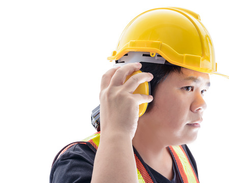 ear muffs: male construction worker with Standard construction safety equipment  and closeup at Ear muffs isolated on white background