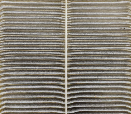spare part: Closeup Used air filter for car, auto spare part Stock Photo