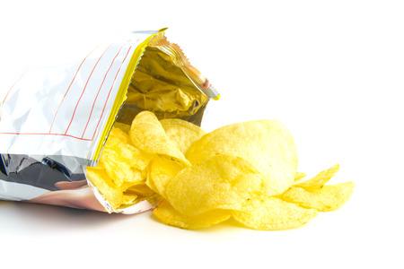 potato crisps: heap of potato crisps on white background Stock Photo