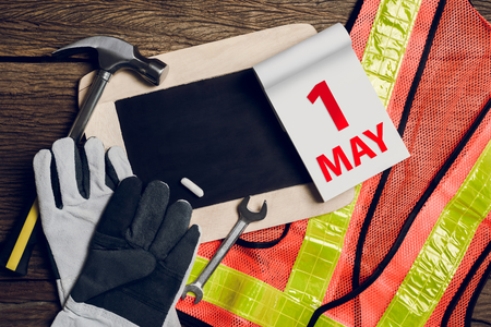 protective clothing: slate board, protective clothing and Hand Tool on wooden background. Concept May Day, May 1
