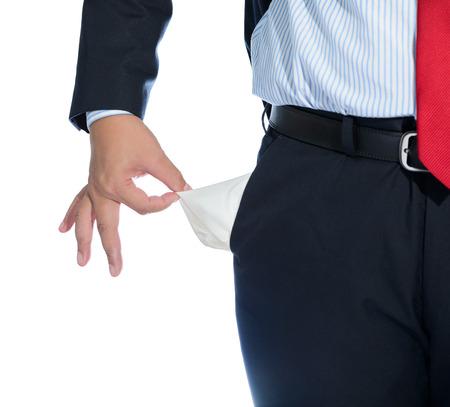 moneyless: Businessman Pulling out Empty Pocket Isolated on white background