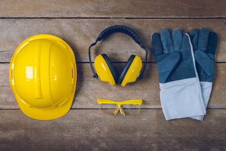 Standard construction safety equipment  on wooden table. top view