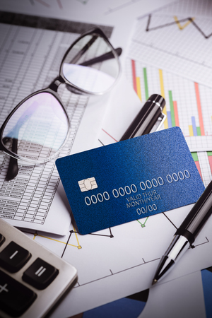 account statements: Close up of a credit cards with credit card statements,account,pen, calculator and glasses