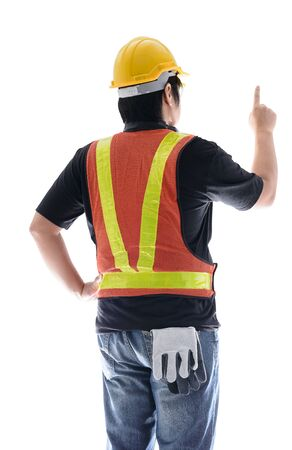 rear view of male construction worker with Standard construction safety equipment and pointed the finger isolated on white background Stock Photo