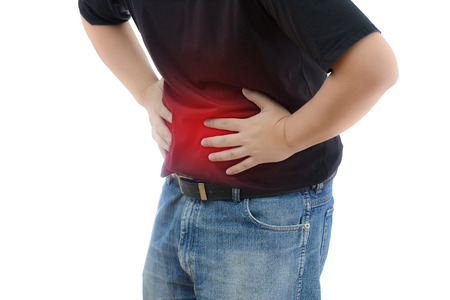 convulsion: Abdominal Pain. Man suffering from stomach ache. He holds his stomach and has hurt. on white background with clipping path