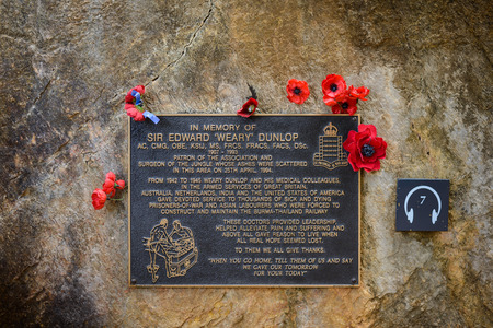 hellfire: KANCHANABURI, THAILAND - September 17, 2016: plaque in memory of Sir Edward Weary Dunlop at Hellfire pass Memorial .The Hellfire Pass Memorial and Memorial Museum were set up to commemorate the fallen