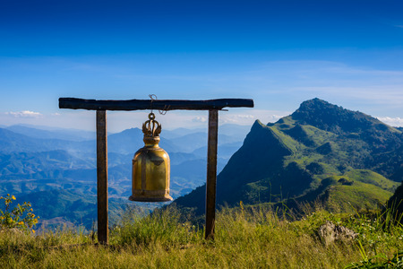 tang: bell on Doi Pha Tang viewpoint ,Chiang Rai province in Thailand.  beautiful location and very popular for photographers and tourists Stock Photo