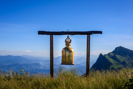 beautiful location: bell on Doi Pha Tang viewpoint ,Chiang Rai province in Thailand.  beautiful location and very popular for photographers and tourists Stock Photo