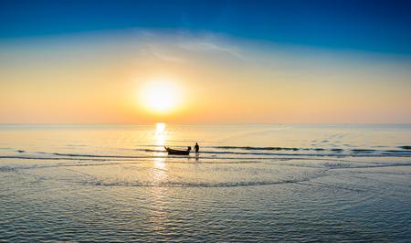 khan: Silhouette of fishing boat and Beautiful tropical sunrise on the beach at Hua Hin, Prachuap Khiri Khan, Thailand